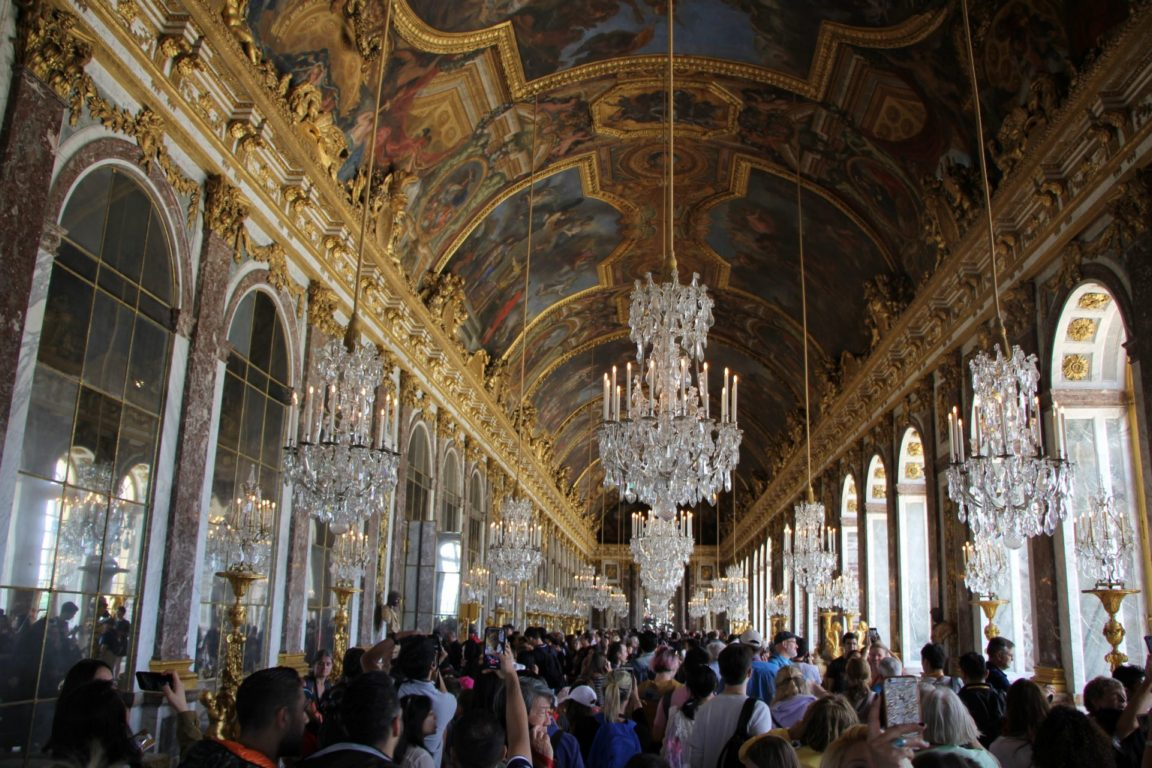 very busy crowds hall of mirrors versailles palace