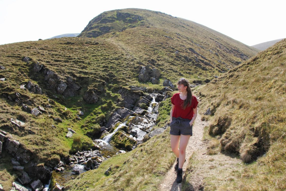 girl walks by Cautley Spout